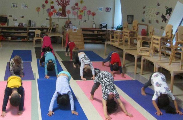 Casa children practicing yoga