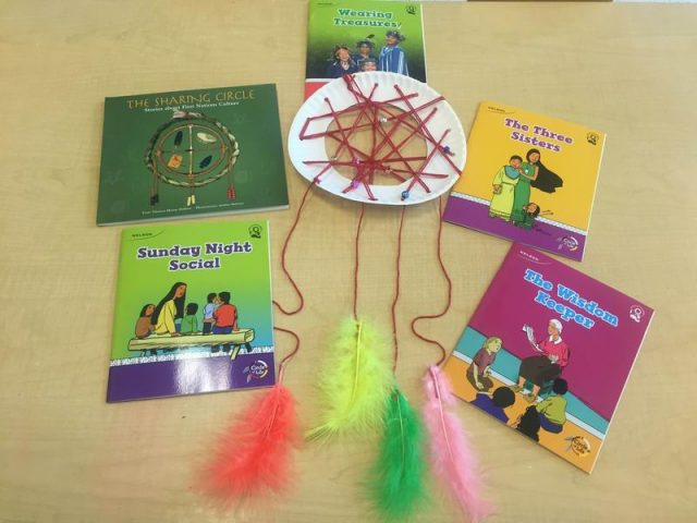 A finished dream catcher and books about Aboriginal culture