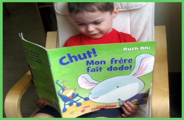 child looking at a French book