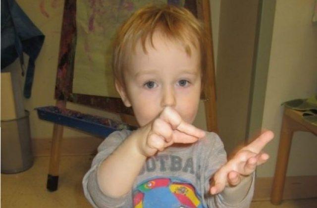 child under 3 signing cookie