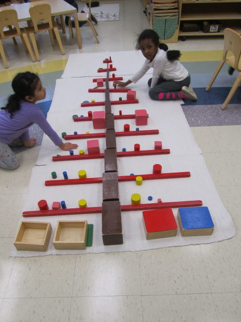 Casa children building holiday tree with Sensorial materials