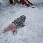 child under 2 playing in the snow