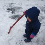 child under 2 shovelling snow
