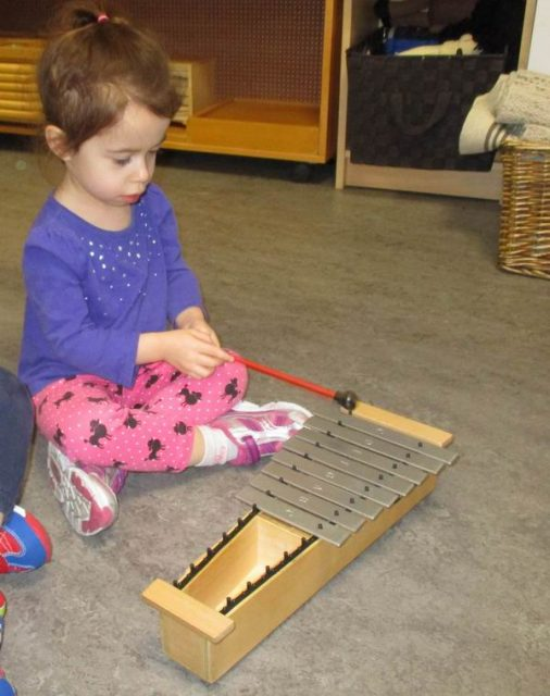 Child playing a metallophone