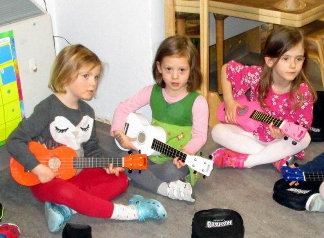 Children playing ukeleles