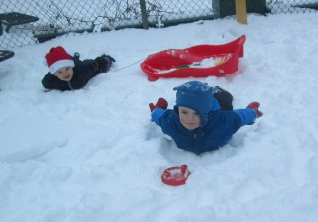 """Children """"diving"""" into the snow"""