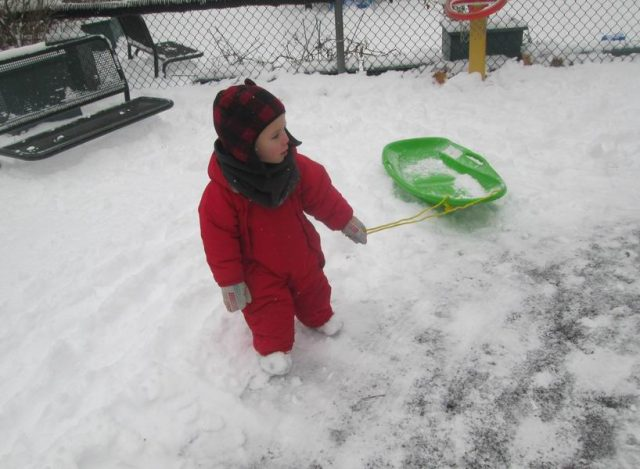 Child pulling a sled