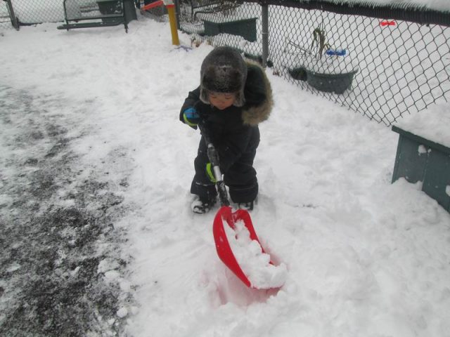 Child shoveling snow