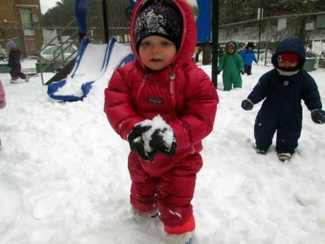 Child making a snowball
