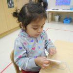 Child under 3 sewing
