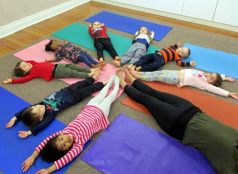 Children engaging in yoga with Cheeba